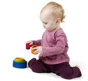Young child playing with colorful toy blocks Royalty Free Stock Photography