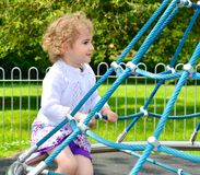 Young child playing in the playground. Royalty Free Stock Photo
