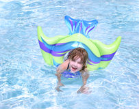 Young Child Playing in a Pool Royalty Free Stock Photos