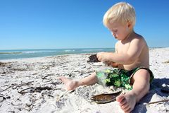 Young Child Playing in Sand at Beach Royalty Free Stock Photos