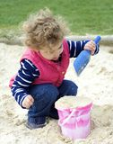 Young child playing with sand. Royalty Free Stock Photos
