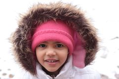 Young Child Playing in Snow Royalty Free Stock Images