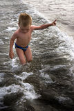 Young child playing in the waves Stock Photography
