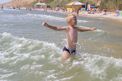 Young child playing in the waves Stock Photo