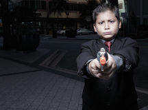 Young child pointing a gun Royalty Free Stock Images