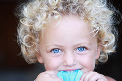 Young child portrait. A portrait of a pretty young child with fair hair and blue eyes Stock Images