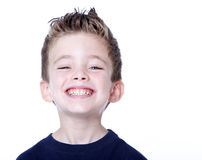 Young child portrait. Happy young boy with smile on his face on white Royalty Free Stock Image