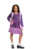 Young child posing in purple outfit Stock Images