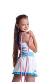 Young child posing with skipping rope isolated Royalty Free Stock Photography