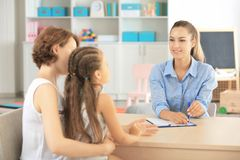 Young child psychologist working with family in office royalty free stock images