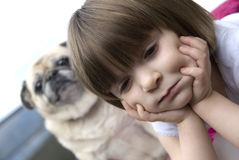 Young child with pug Royalty Free Stock Photo
