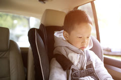 Young child reading book in car Royalty Free Stock Photos