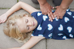 Young child receiving first aid stock image