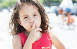 Young child in a red shirt needs silence royalty free stock photo