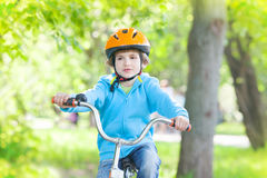 Young child riding bike Stock Image