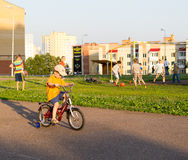 Young child Riding a Bike. Child riding his small bike with stabilisers in summer Royalty Free Stock Photos