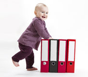 Young child with ring file Stock Images