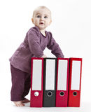 Young child with ring file Stock Image