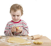 Young child with rolling pin and dough Royalty Free Stock Images