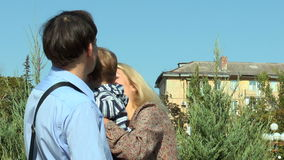 A young child's parents dress jacket stock video footage
