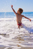 Young child in the sea Stock Photography