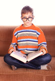 Young child sitting with book Royalty Free Stock Images
