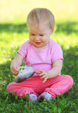 Young child sitting on grass Stock Photos