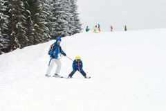 Young child, skiing on snow slope in ski resort in Austria Stock Image