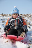Young child on sledge Royalty Free Stock Images