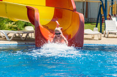 Young child sliding down a waterslide Stock Image