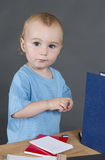 Young child at small desk Stock Photos