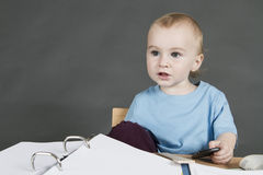 Young child at small desk Stock Image