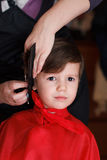 Young child with smile at the hairdresser Royalty Free Stock Images