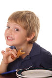 Young child smiling over breakfast Stock Photography