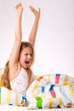Young child is stretching Stock Images