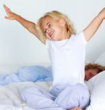 Young child stretching after sleeping Stock Photography