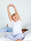 Young child stretching after sleeping Royalty Free Stock Image