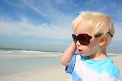 Young Child in Sunglasses Looking at the Ocean Stock Photos