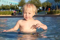 Young Child Swimming in Large Children's Pool Royalty Free Stock Image