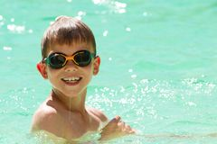 Child swimming in the pool Royalty Free Stock Photo