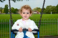 Young child on a swing Royalty Free Stock Image