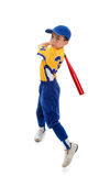 Young child swinging a baseball bat. A young child wearing a baseball or softball uniform swinging a bat on a white background Royalty Free Stock Images