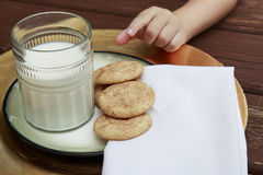 Young Child taking a Snickerdoodle cookie from the plate Royalty Free Stock Images