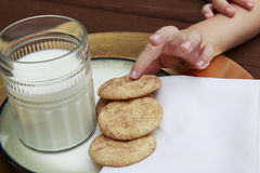 Young Child taking a Snickerdoodle cookie Stock Images