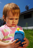 Young child with toy phone Stock Photos
