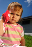 Young child with toy phone Royalty Free Stock Photo