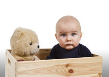 Young child with toy in wooden box Stock Image