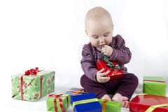 Young child unpacking presents Stock Photography