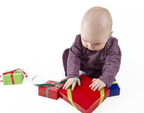 Young child unpacking presents Royalty Free Stock Photography