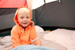 Young Child Waking up in Tent after Camping Stock Photos